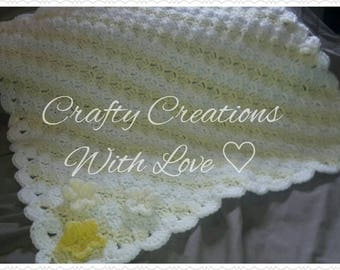 Lemon and white baby blanket with flower appliques
