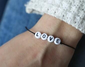 Customizable bracelet white beads on cotton thread