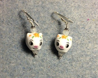 White, pink and black ceramic pig bead earrings adorned with white Chinese crystal beads.