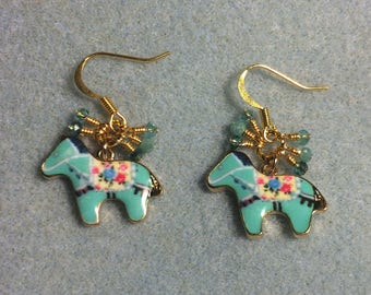 Turquoise enamel Scandinavian horse charm earrings adorned with tiny dangling turquoise Chinese crystal beads.