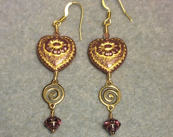 Pinkish with gold inlay Czech glass heart bead dangle earrings adorned with gold swirly links and pinkish purple Czech glass Saturn beads.