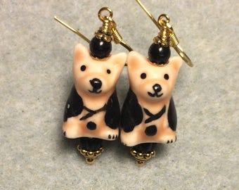 Tan and black ceramic puppy dog dangle earrings adorned with black Czech glass beads.