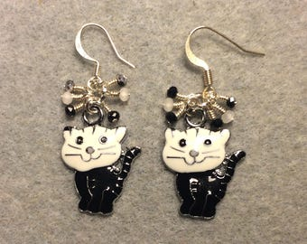 Black and white enamel cat charm earrings adorned with tiny dangling black and white Chinese crystal beads.
