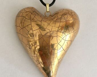 Large gold heart pendant.