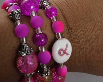 Pink breast cancer pink ribbon wrapped beaded bracelet