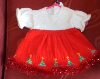 Hand knitted Christmas themed dress to fit a baby girl aged 3-6 months old
