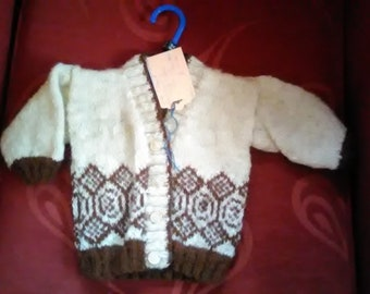 Hand knitted cardigan,  knitted with home spun wool, to fit a child aged 3-6 months old