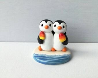 Ice lolly penguins, miniature penguins at the beach, cute pottery mini penguins, seaside theme