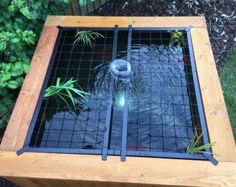 Koi pond etsy for Garden pond safety covers