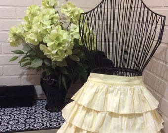 Ruffled half  apron with yellow and white stripes