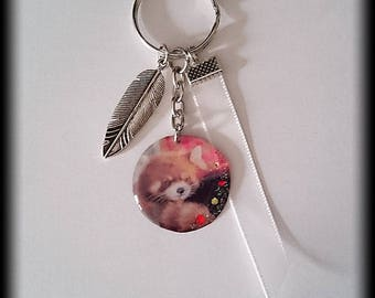 Key charm and Ribbon red pandas