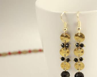 Black beads and gold earrings
