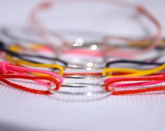 genuine orange cord and silver bracelet