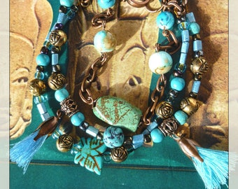 "Ethnic bracelet ""TIKAL"" 3 rows, copper metal, glass beads, turquoise gem stones, tassels"