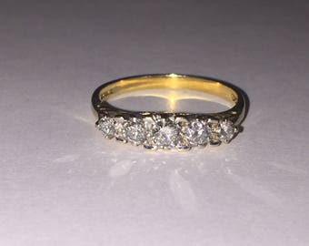 An Art-Deco Style 5 Stone Diamond Ring. English hallmarks. 0.65ct in total.