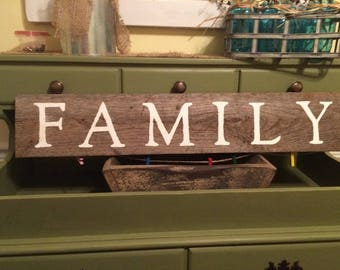Distressed Family Sign with twine and clothespins for pictures