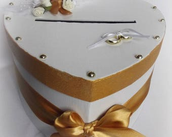 White and gold with flowers and bow wedding urn