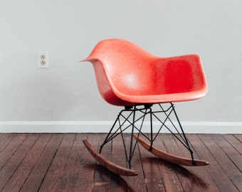 Early Edition Eames Fiberglass Armchair in Rare Salmon Color.  Excellent vintage condition