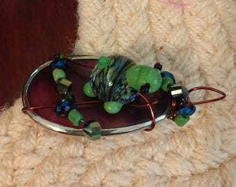 Wired turtle pendant.