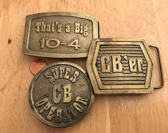 Collection  of 3 CB er ,CB operator and Big 10-4 belt buckles. Metal . 1976 . Made in USA. Very good condition