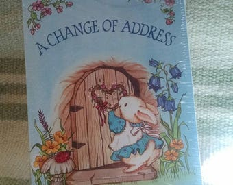 A Change of Address Sealed Package Announcement Cards