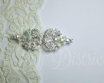 Beautiful button clasp in metal, Crystal rhinestones. 2.8 x 7.4 cm