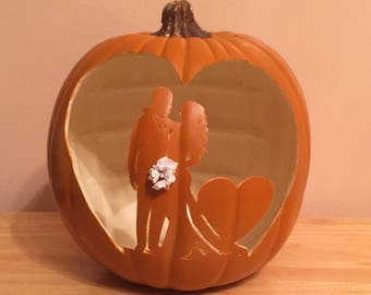 "9""  Orange Pumpkin Groom and Bride with flowing hair and bouquet of flowers"