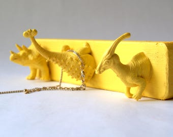Wall pegs Yellow Dinosaurs. Hooks for storage and decoration. Wall organizer for jewelry or light clothes. Jewelry rack. Light Yellow, 20 cm