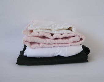 Mixed lot of solid fabric remnants - white, pink and black