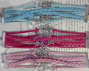 Multiple wristbands in leather with charms and pearls