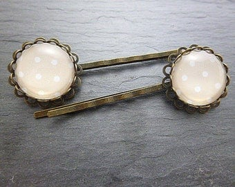 Set of 2 hair pins white dots on beige background