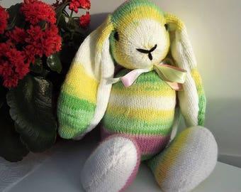 Light Rainbow Rabbit, hand knitted soft toy.