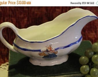 Christmas in July Sale Ceramic Gravy Boat with Dutch Woman Transfer and Blue Hand Painted Trim