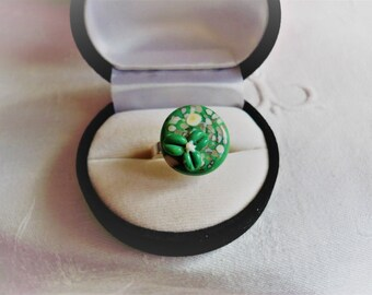 Green lampwork cabochon and silver plated ring