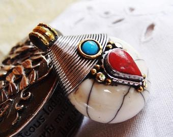 Nepalese white resin pendant