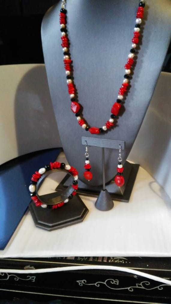 Coral wonder red coral white pearls and black onyx