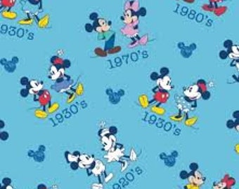 "Mickey and Minnie through the years by Springs Creative fabric, By the Half Yard, 43"" wide, 100% cotton"
