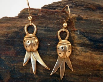 ladybird earrings handmade in bronze