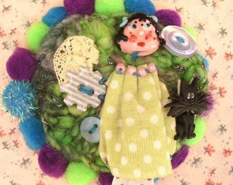 Textile and Lampwork Glass brooch.