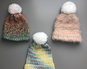 Your choice of baby girl knitted hats. Size 6-12 months knitted hats, pom poms