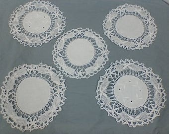 Round white vintage linen placemats.