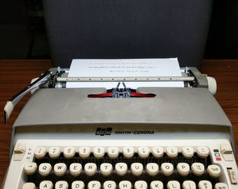1964 grey Smith Corona Galaxie portable typewriter with case