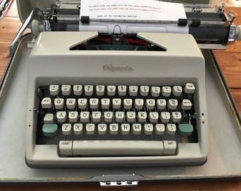 1966 Olympia SM9 typewriter with case - wide carriage and works great!