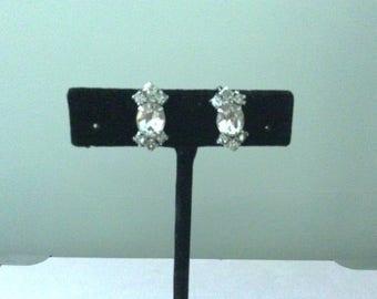 Rhinestone earrings.  Screw back.