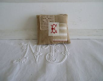 Door with cross stitch initial cushion