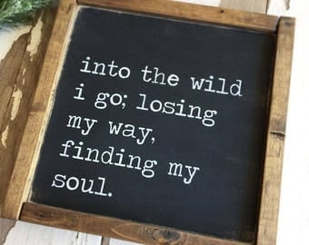into the wild - wood sign