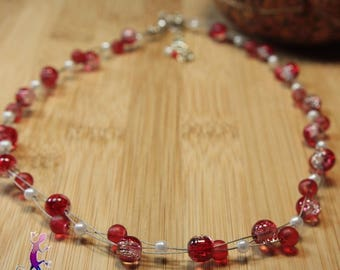 Braided with red glass beads necklace