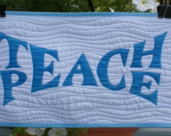 "Teach Peace quilted wallhanging in blue 14"" x 24"""