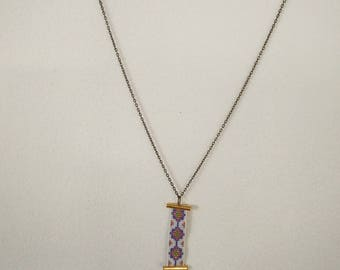 ethnic necklace and purple tassel necklace