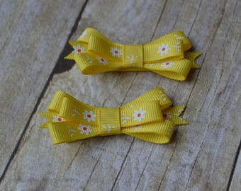 yellow flower pigtail bow clips